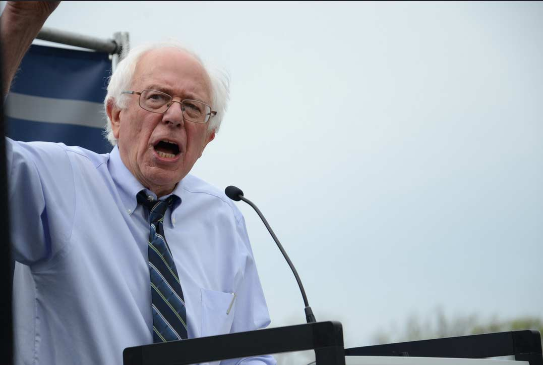 Black Lives Matter protesters take stage from Bernie Sanders during speech