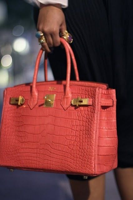 Woman holding Croco Hermes Birkin Bag